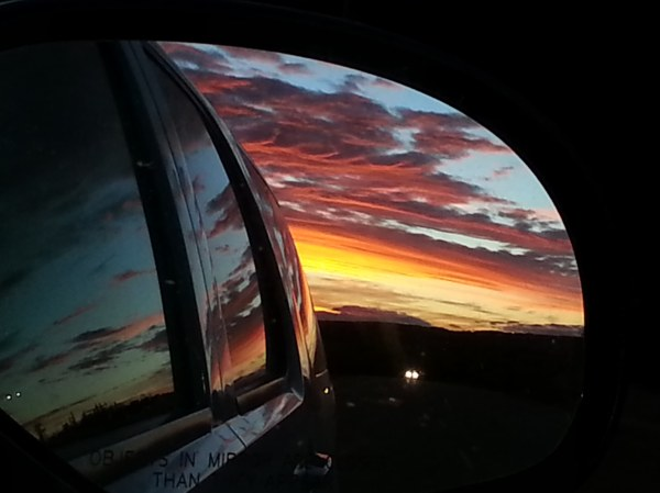 A westward sky in the rear-view mirror