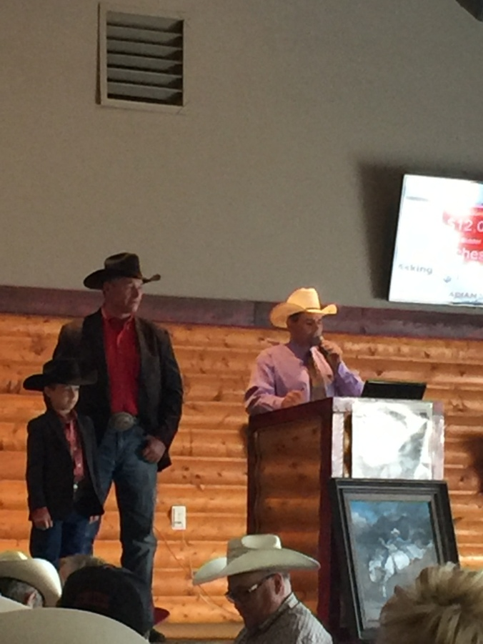 on stage at Ponoka auction